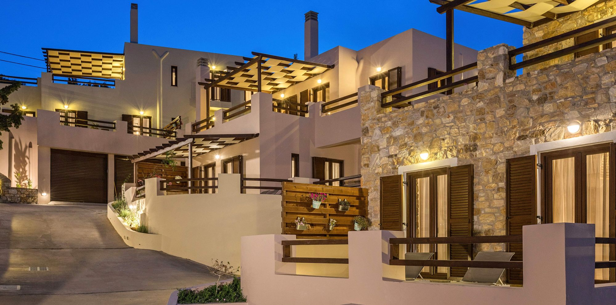 Night external view of Syra Suites residences in Syros island.