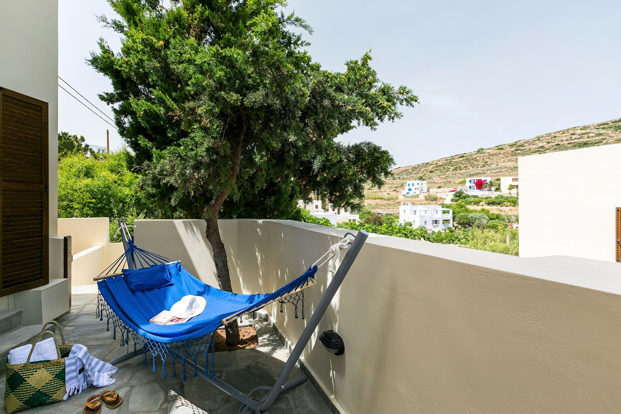 A blue hammock at a Syra Suite veranda.