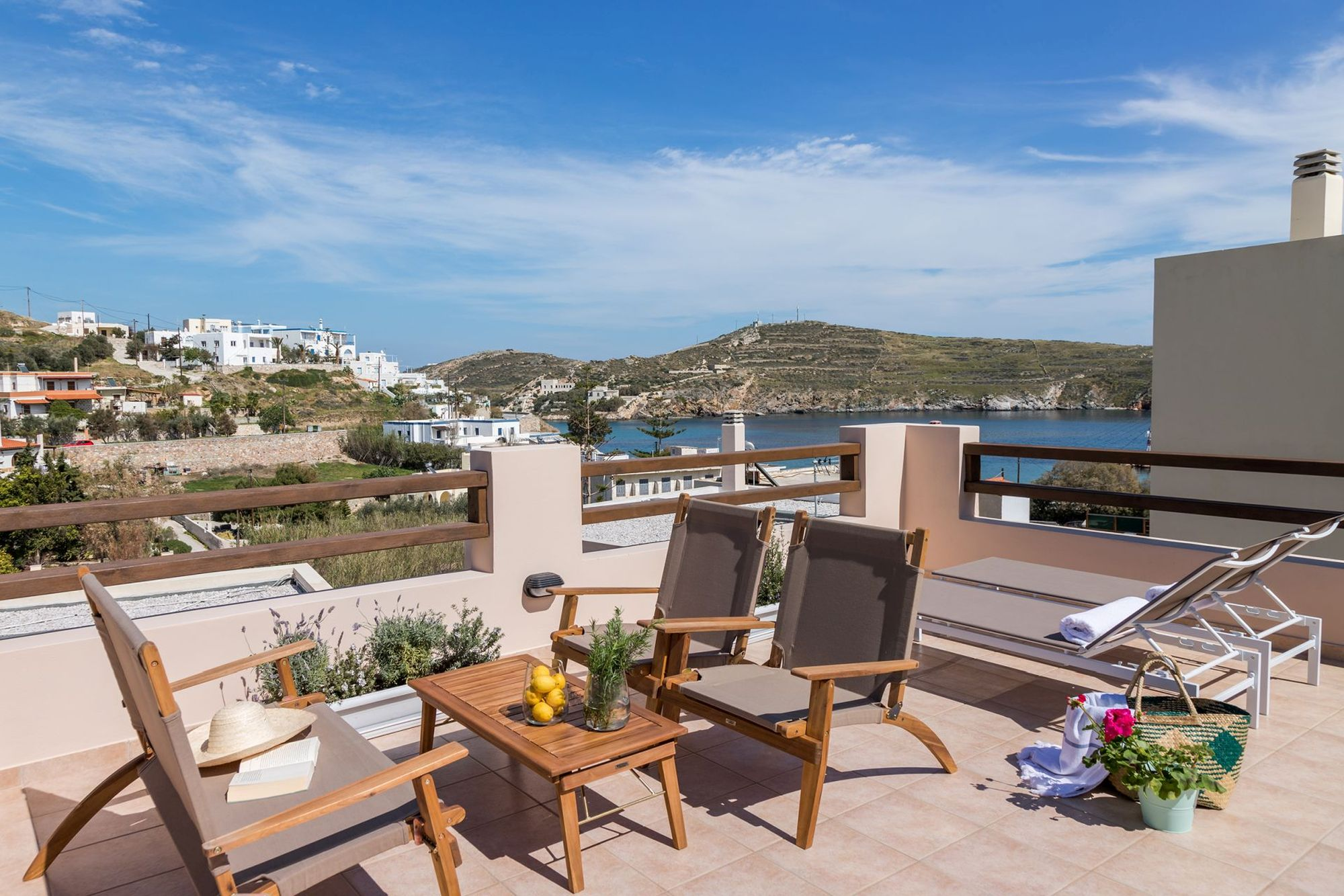 Spacious sea view veranda with lounge, two sunbeds and lovely flowerpots.